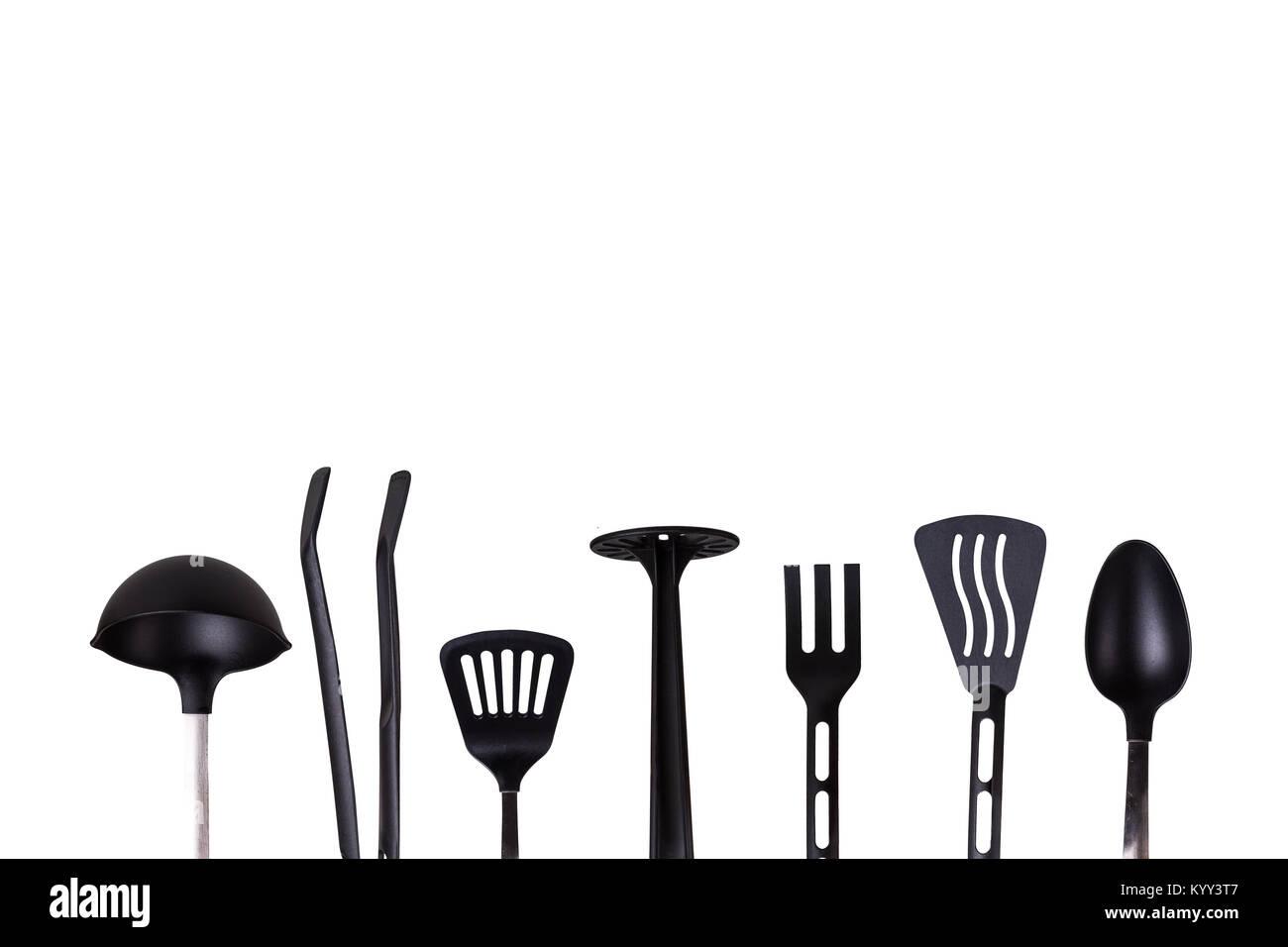 View of black plastic kitchen tools, serving stuff like spatula ...