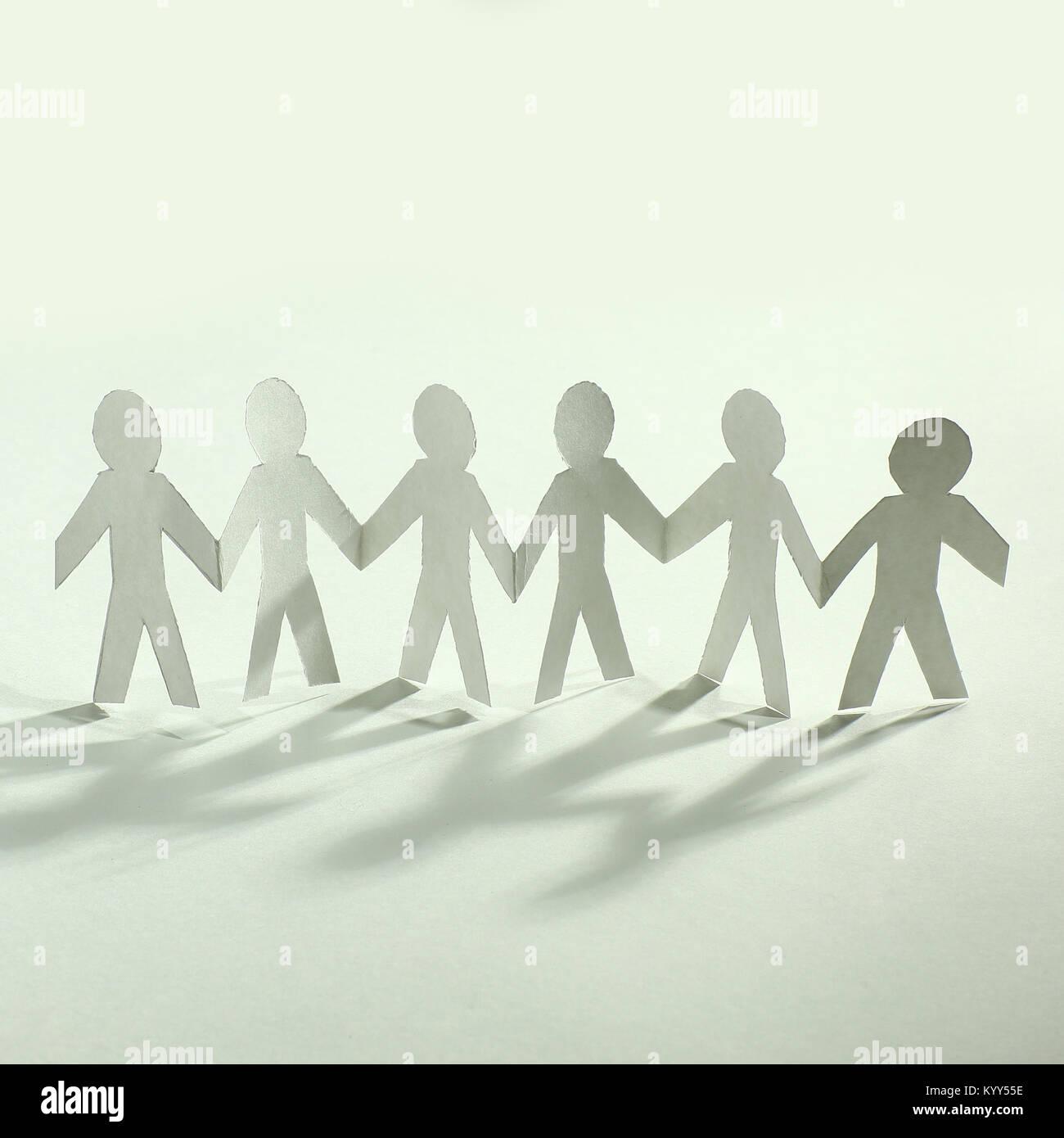concept of teamwork.team paper men standing Stock Photo