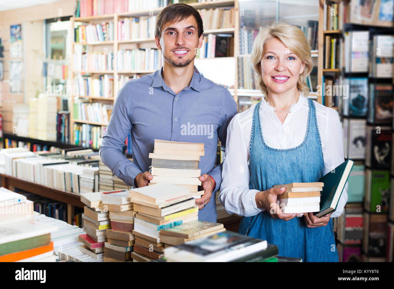 Young Man Carrying Pile Of Books Stock Photos  Young Man Carrying Pile Of Books Stock -1136