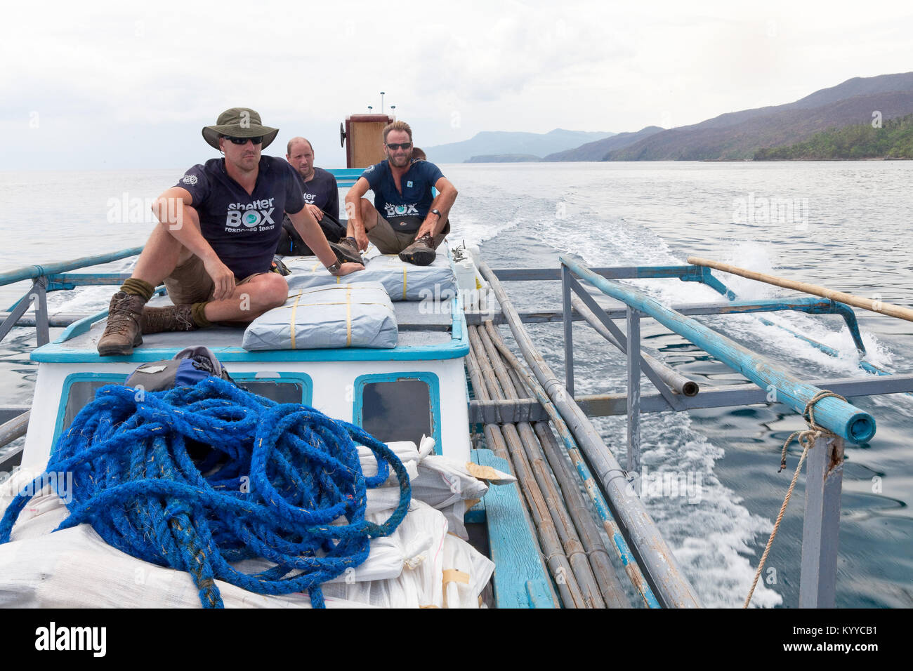 SRT members en route to Rapu Rapu island, Albay, Philippines following Typhoon Glenda/Rammasun 2014. L-R Matt Roberts; - Stock Image
