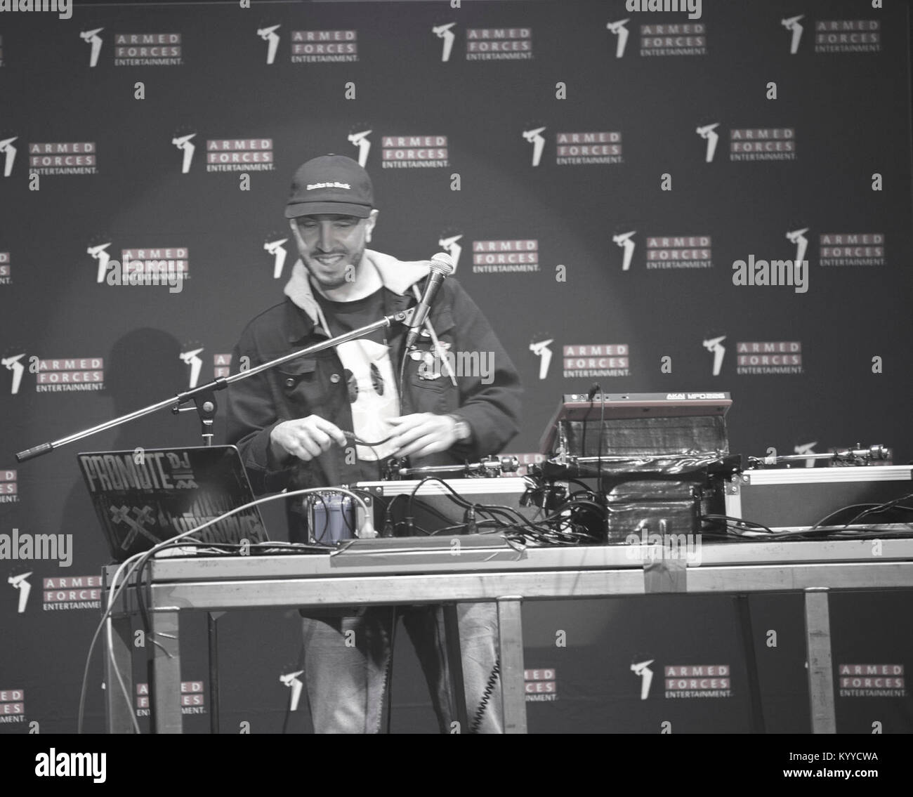 DJ Promote performs original musical mash-ups to open the Lecrae concert held at Marine Corps Air Station Iwakuni, - Stock Image