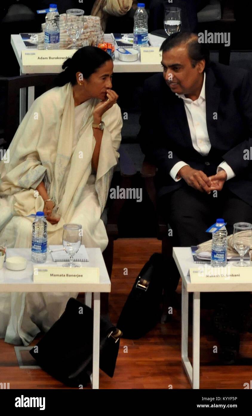 Chief Minister Mamata Banerjee speaks to industrilist Mukesh Ambani during the Bengal Global Business Summit 2018. - Stock Image