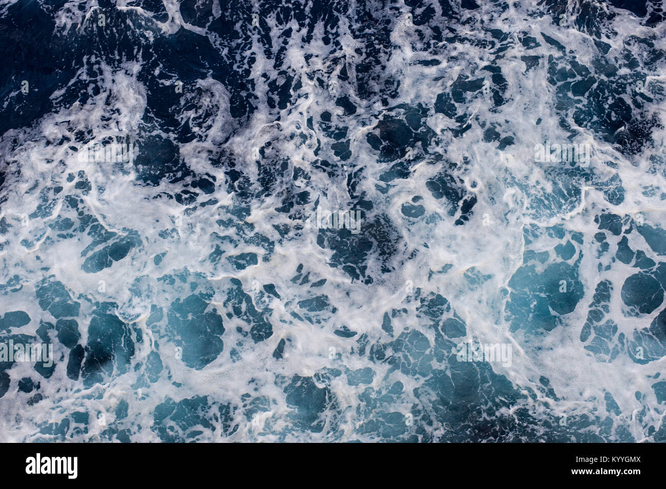 Ocean Surface with Waves and Foam - View from above - View from Boat Stock Photo