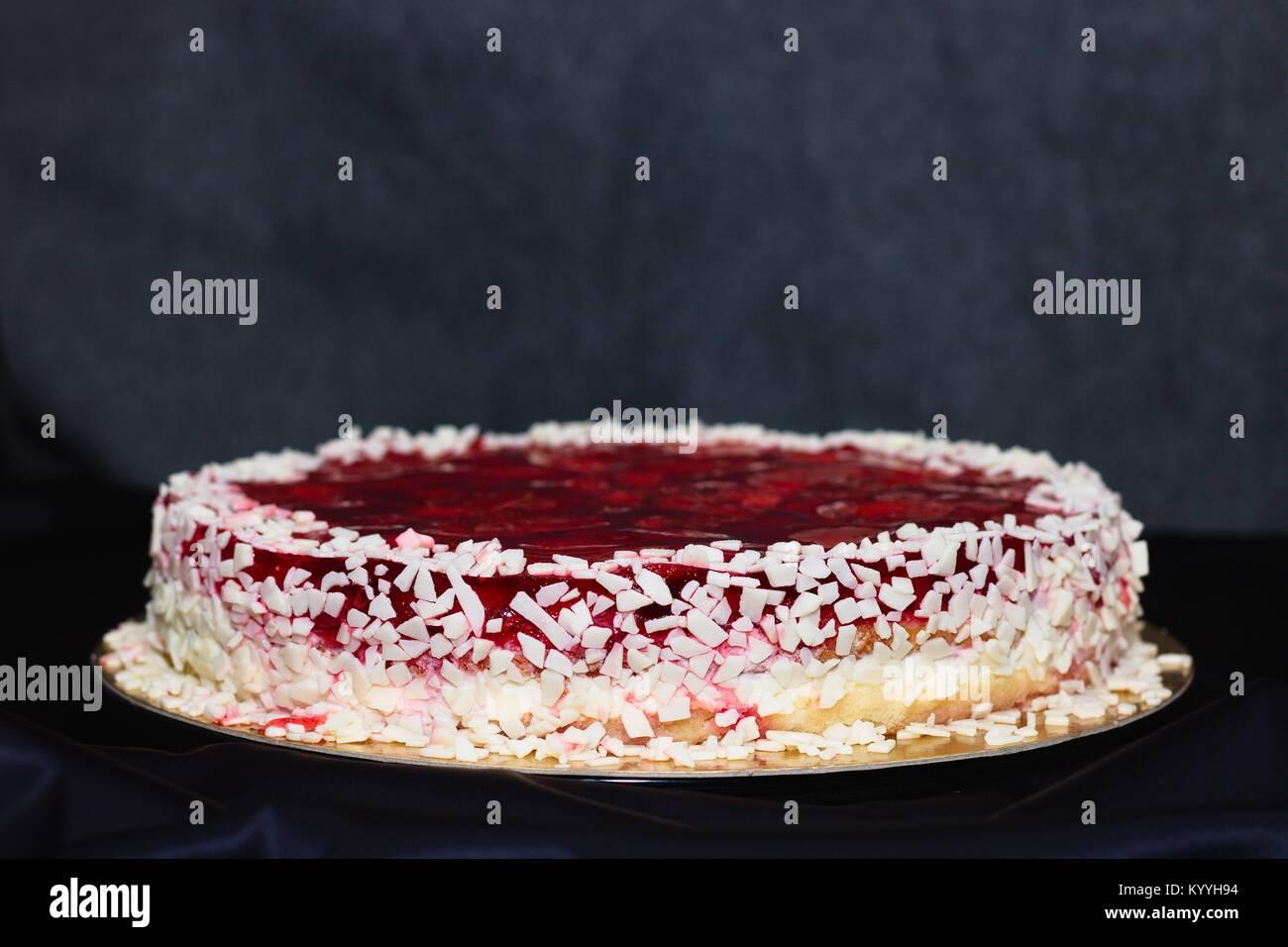 Strawberry Jelly And White Chocolate Birthday Cake On Purple Clad