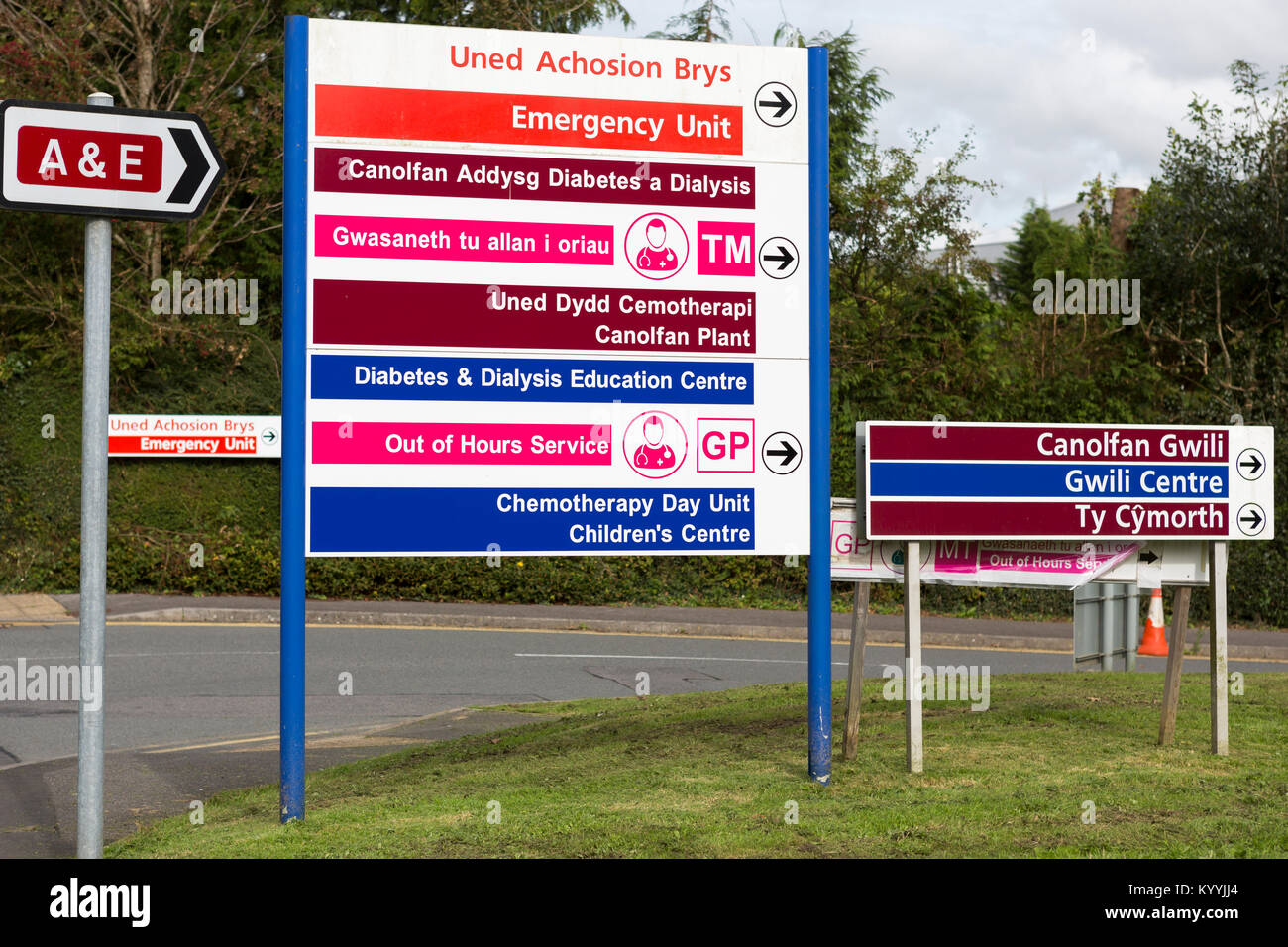 Colourful bilingual - Welsh and English - hospital signs outside a hospital in Wales - Stock Image