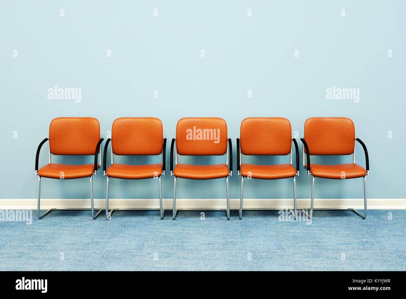 Five waiting room chairs in a row against a wall in an empty room - Stock Image