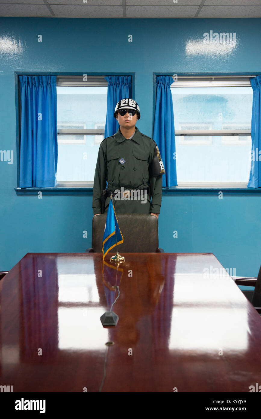 A soldier in the blue conference room, Joint Security Area (JSA), along the Military Demarcation Line between North Stock Photo