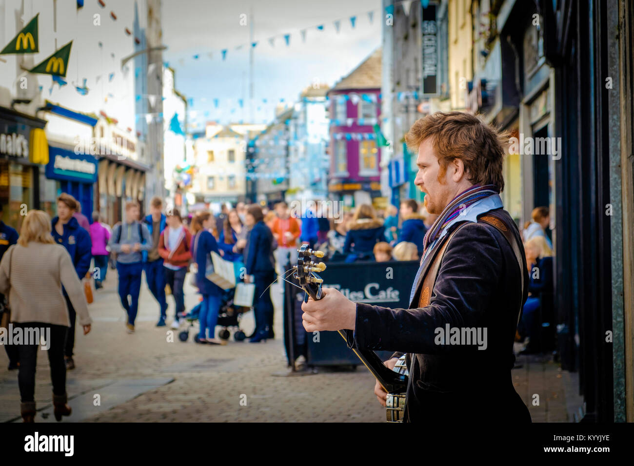 Busker performing on the High Street in Galway, Ireland - Stock Image