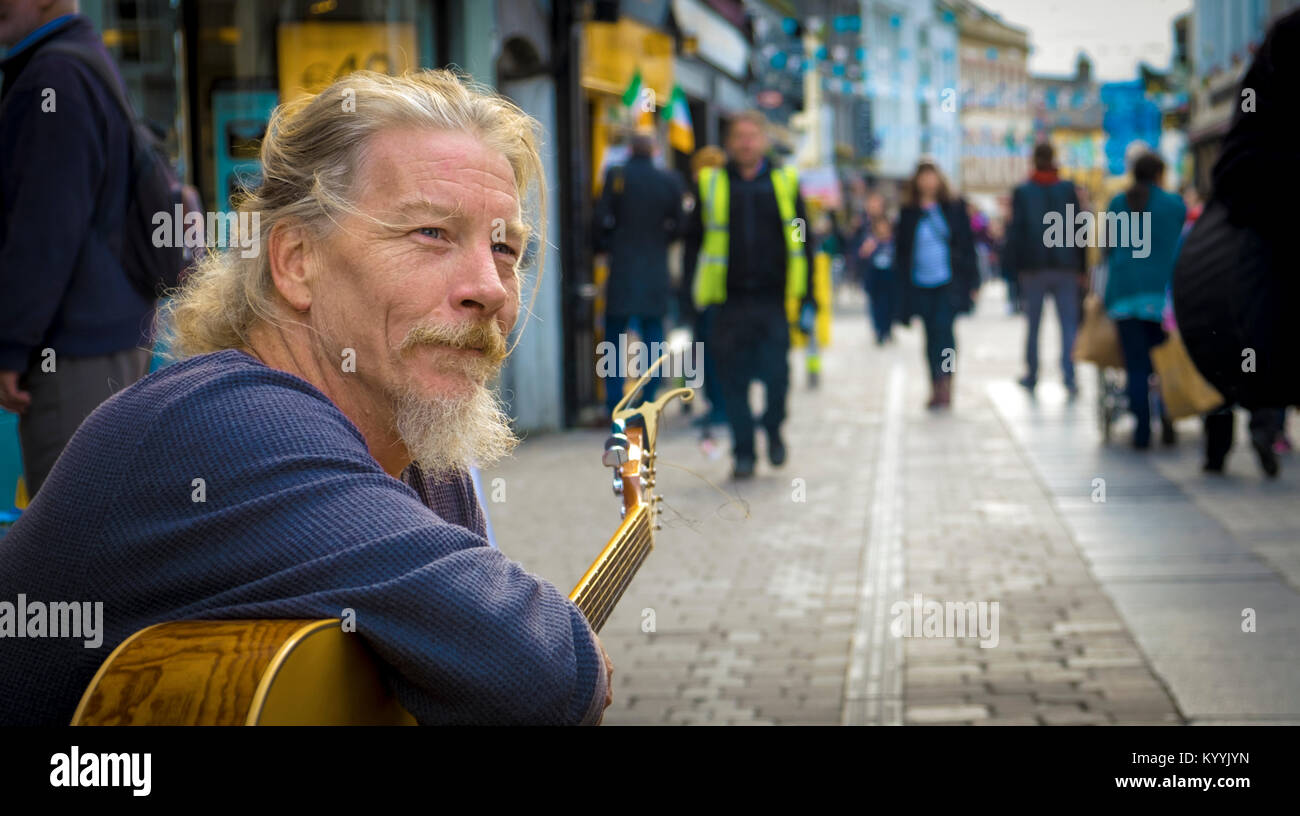 Busker on the High Street in Galway, Ireland - Stock Image