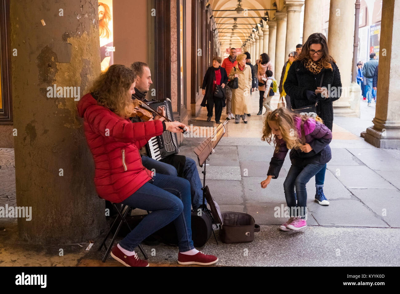 Buskers under the Porticos in Bologna city centre, Italy - Stock Image
