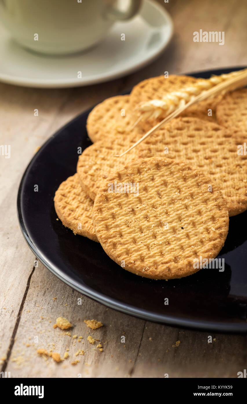 Digestive biscuits on a plate - Stock Image