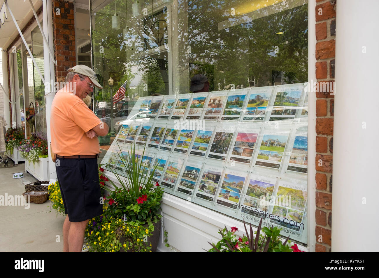 A realtors real estate agency window showing properties for sale, Southampton, The Hamptons, Long Island, New York, - Stock Image