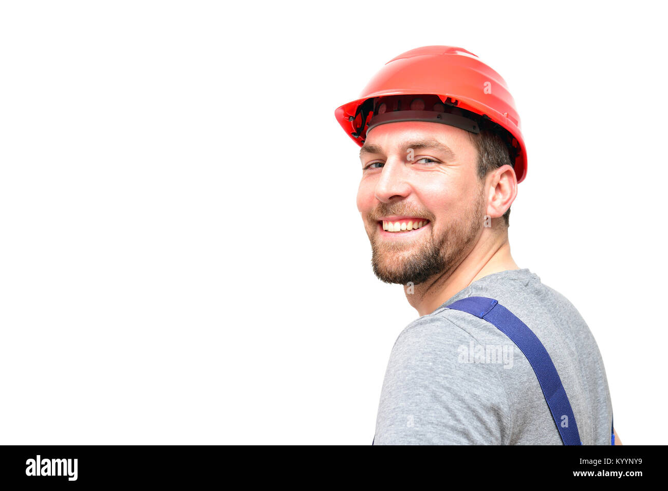 isolated craftsman construction worker assembler workmen - friendly worker in working clothes on white background - Stock Image