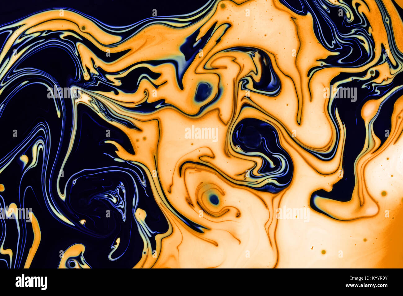 Swirling paint oil abstracts of water and acrylic paint creating a hazardous pollution theme for environment and - Stock Image