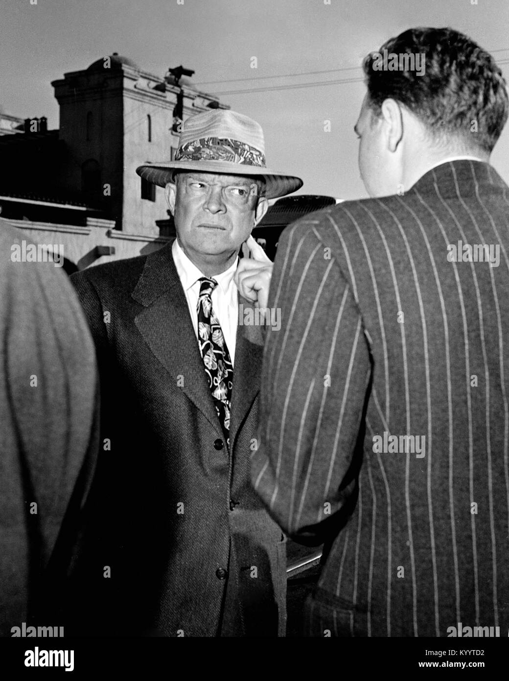 President Dwight Eisenhower looks curiously at Richard Nixon with his back to the camera. circa 1957. - Stock Image
