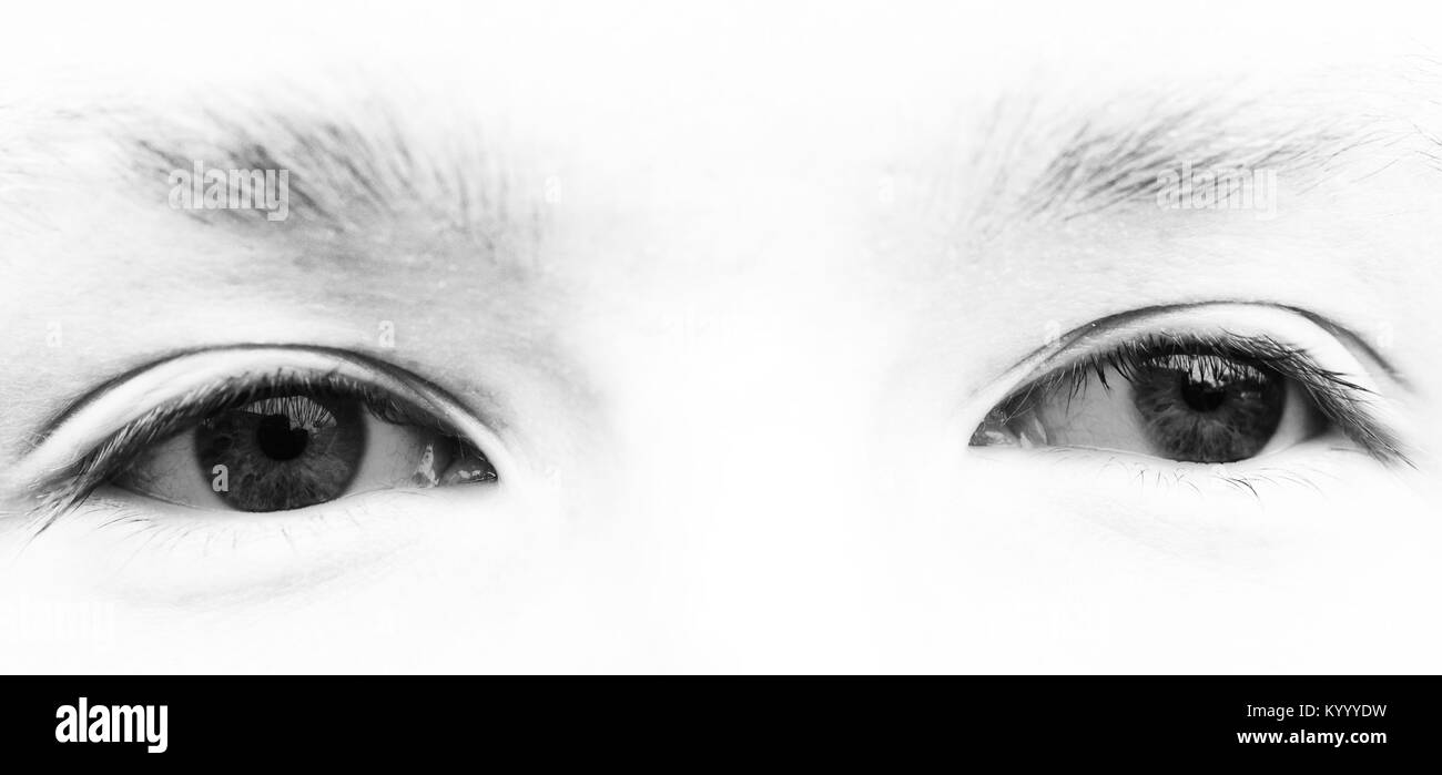 Male eyes overexposed black and white - Stock Image
