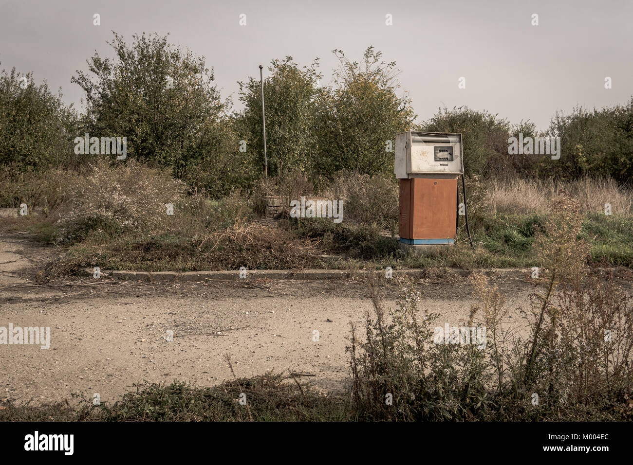 Rusty old abandoned gas station in a middle of nowhere - Stock Image