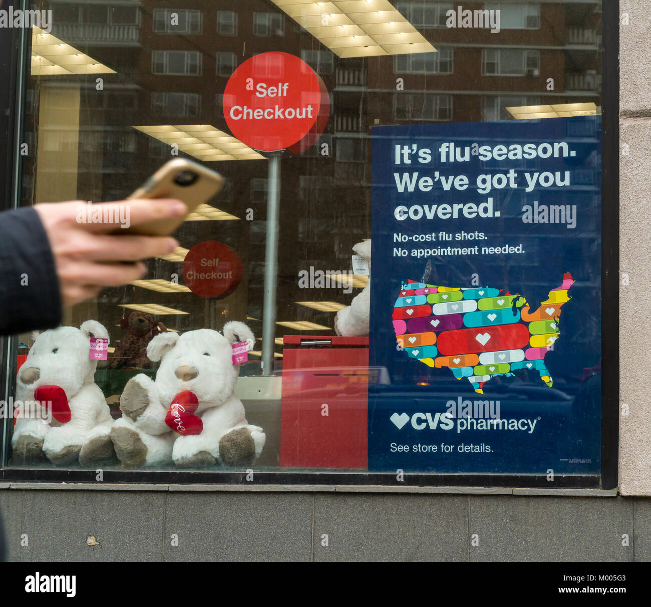 A sign advertises that flu shots are available at a CVS Health drugstore in New York on Tuesday, January 16, 2018. - Stock Image