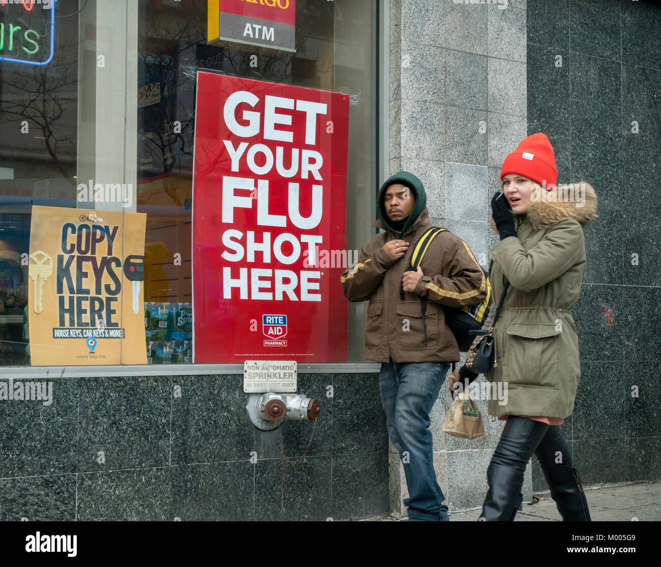 A sign advertises that flu shots are available at a Rite Aid drugstore in New York on Tuesday, January 16, 2018. - Stock Image