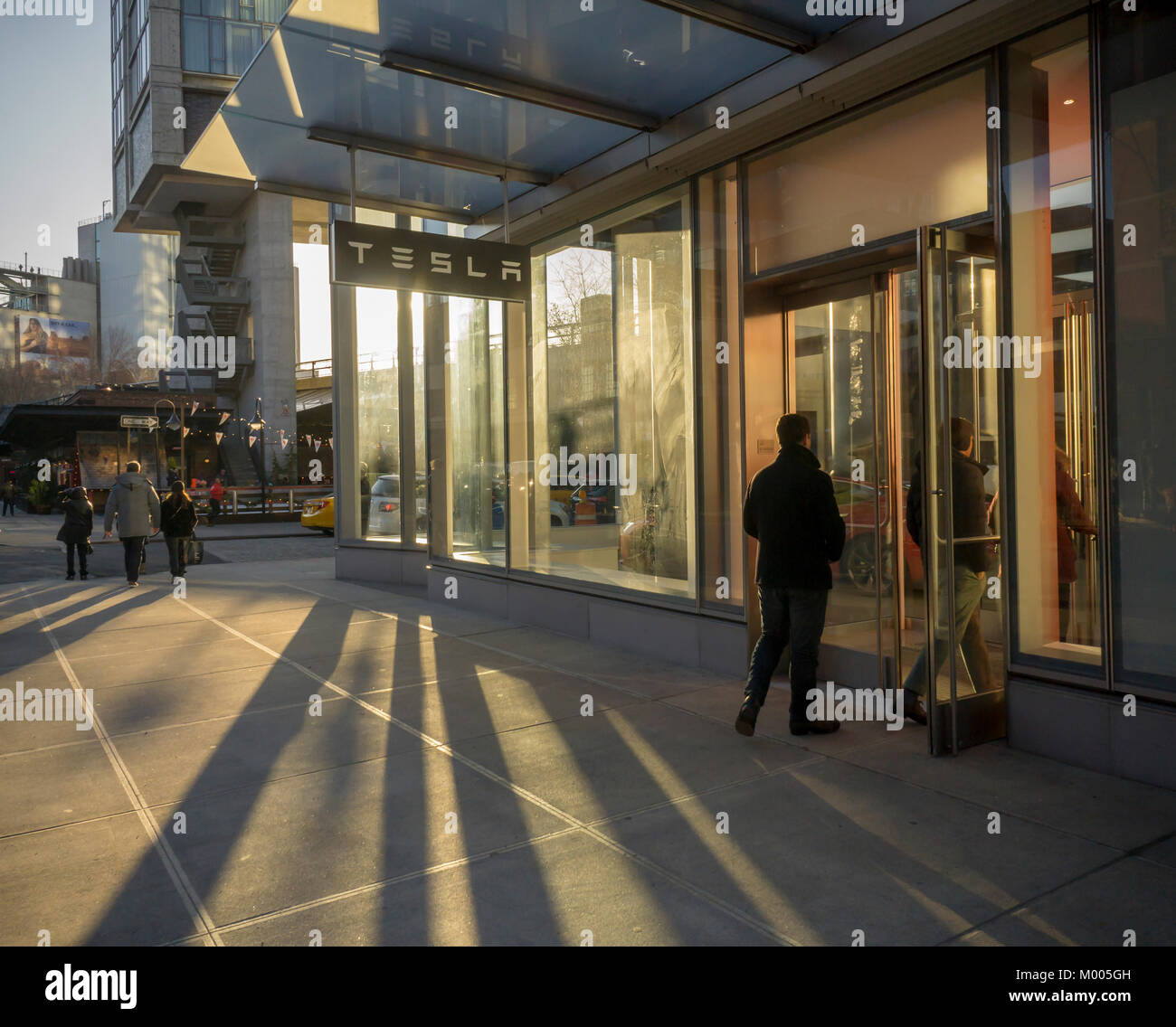 Curious visitors to the new Tesla Motors showroom in the Meatpacking district of New York on Monday, January 15, - Stock Image