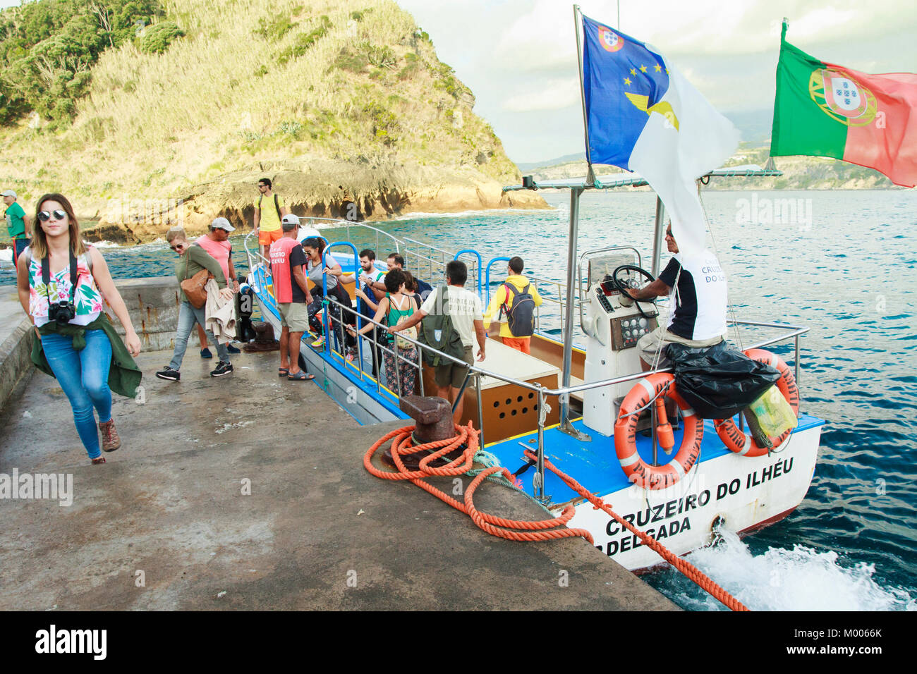 Tourists leaving the boat at islet of Vila franca do Campo at Sao Miguel, Azores, Portugal - Stock Image