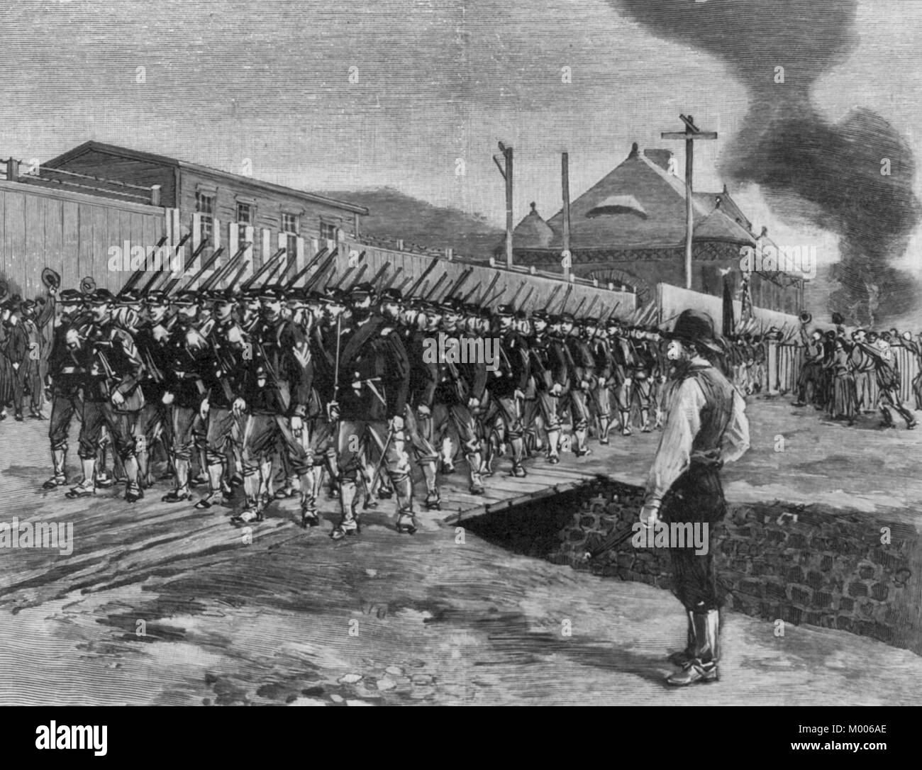 The First Troops in Homestead. The Eighteenth Regiment passing the Office and Works of the Carnegie Company, July - Stock Image