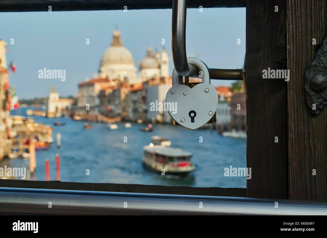Heart shaped love lock on a bridge in Venice Italy - Stock Image