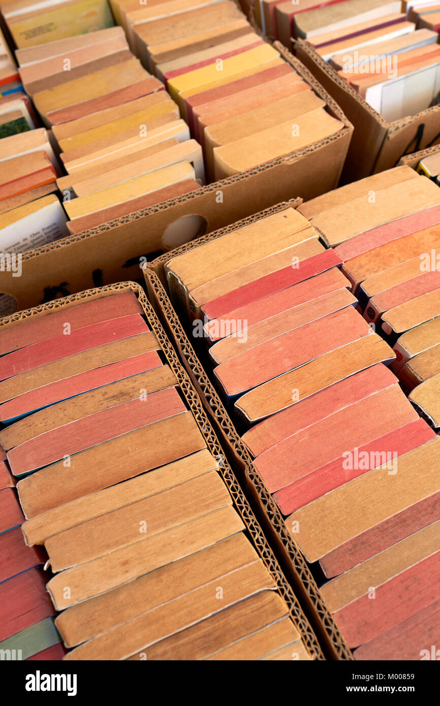 Second hand paperback books for sale on a market stall. - Stock Image