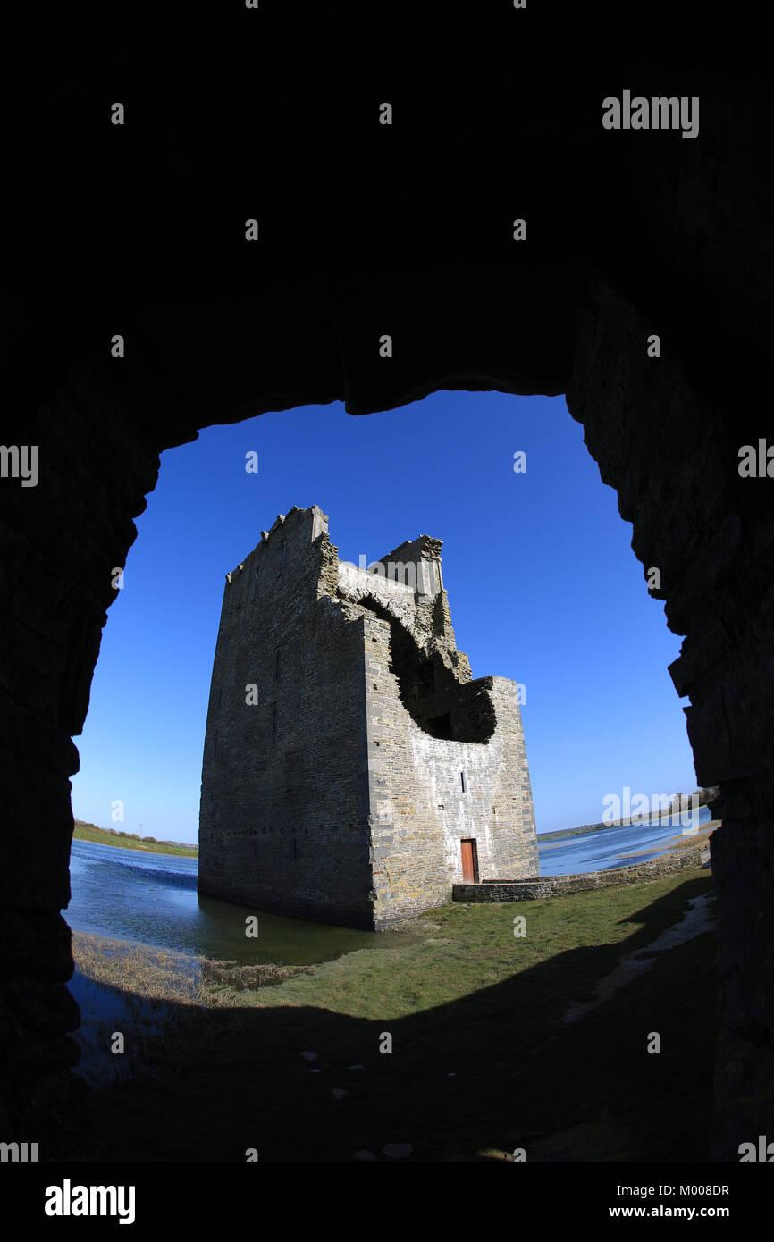 ruined castle on an irish river estuary, wild atlantic way, county kerry, ireland - Stock Image