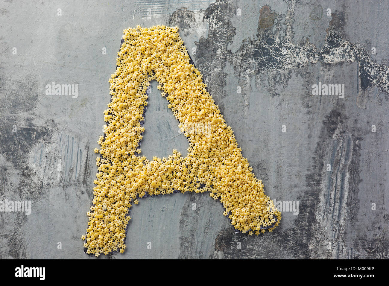 Alphabet made of pasta. Letter A - Stock Image