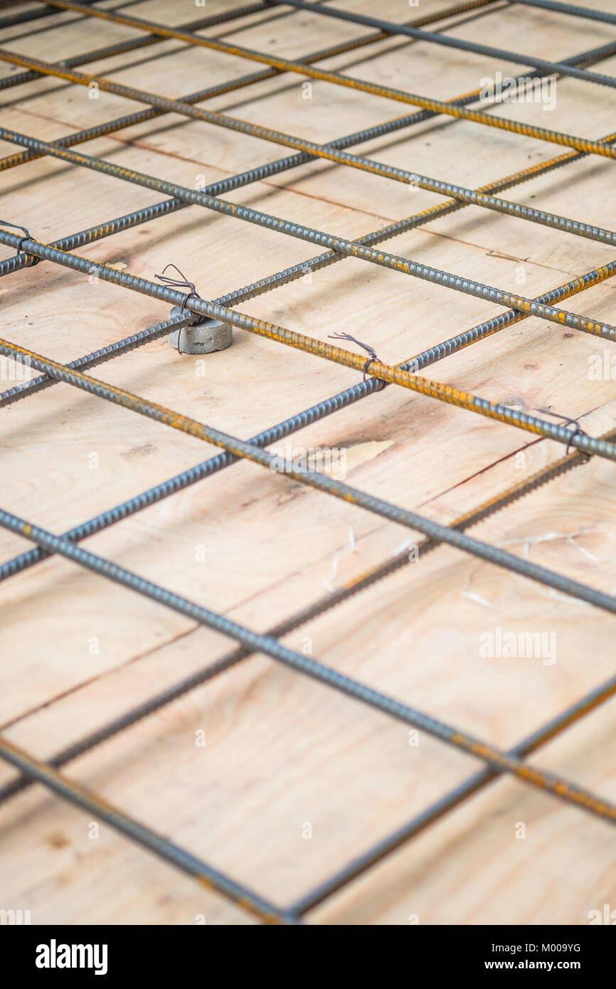 Rebars steel wire mesh, which is supported by mortar cover box and wooden plate for precast concrete flooring on Stock Photo