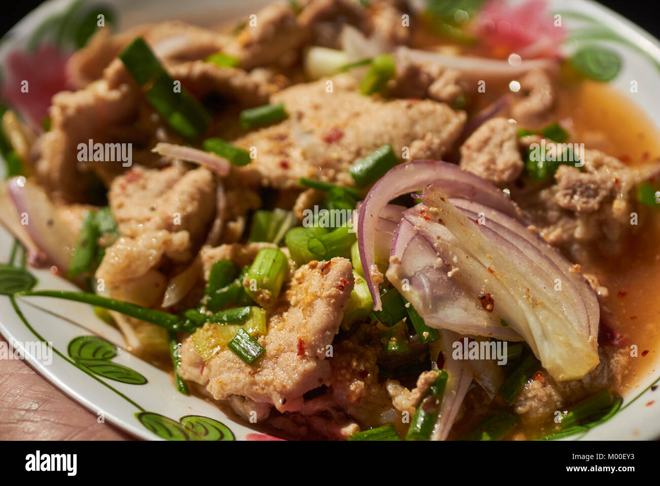Stir fried chicken with basil leaves, a Thai Classic. - Stock Image