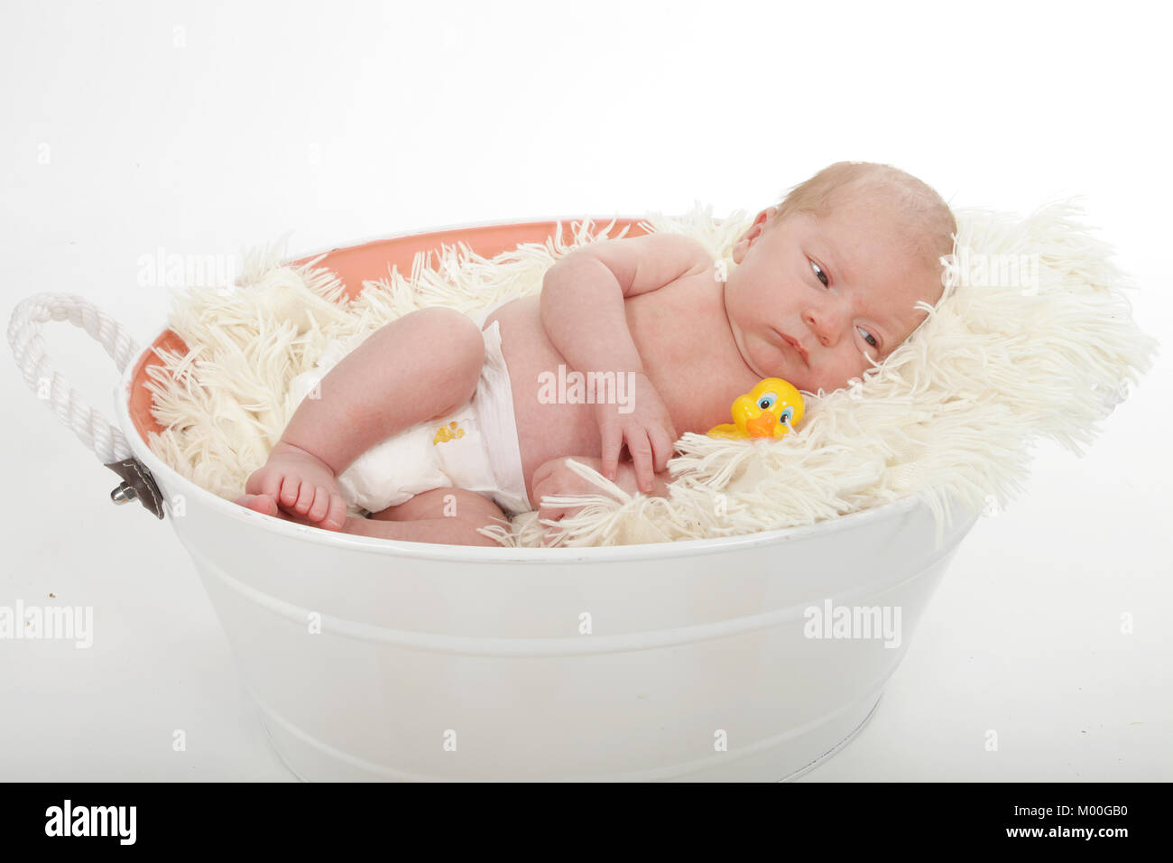 beautiful 4 week old baby boy in the tub with the rubber ducks Stock ...