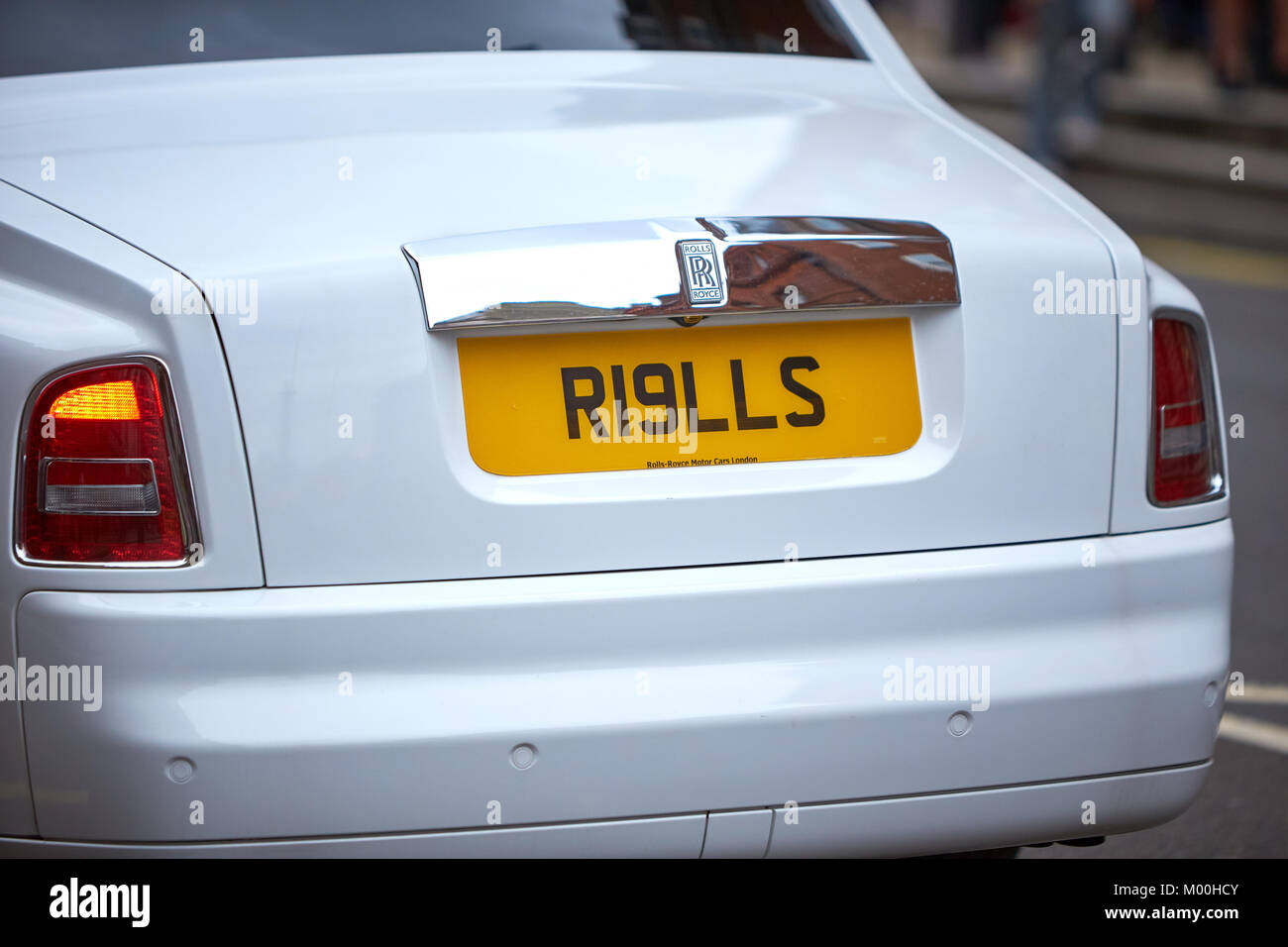 The Tail Lights And Personalised Number Plate Of A White Rolls Royce Stock Photo Alamy