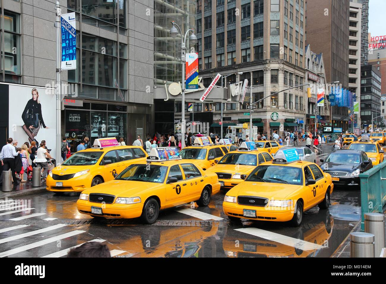 NEW YORK - JULY 3: People ride yellow taxi cabs along 8th ...