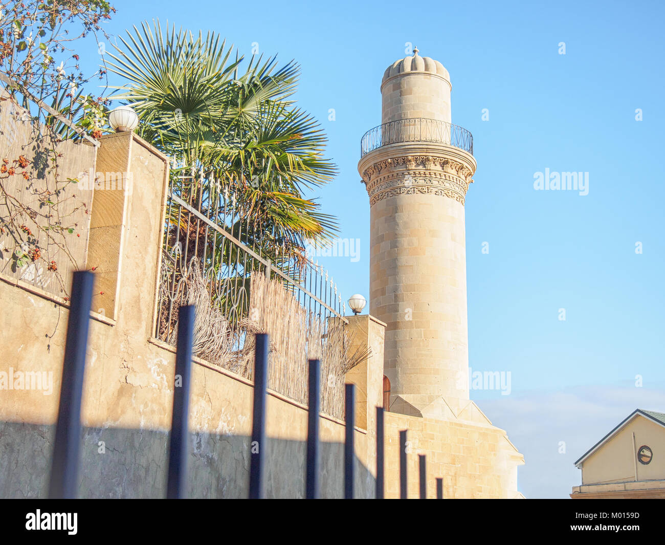 Ancient minaret of Muhammad Mosque in Baku old town - Stock Image