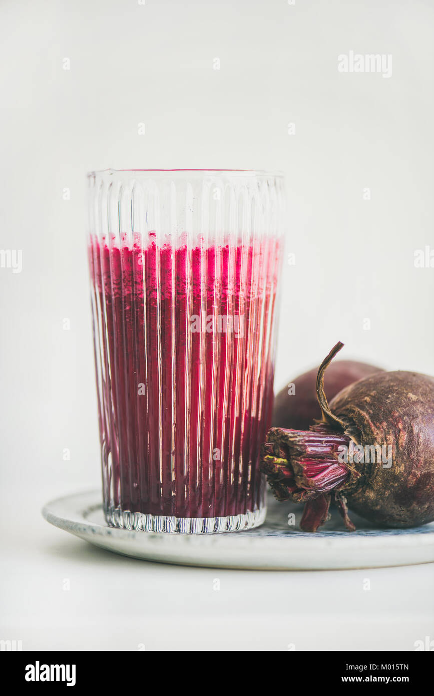 Fresh morning detox beetroot smoothie in glass, white background - Stock Image