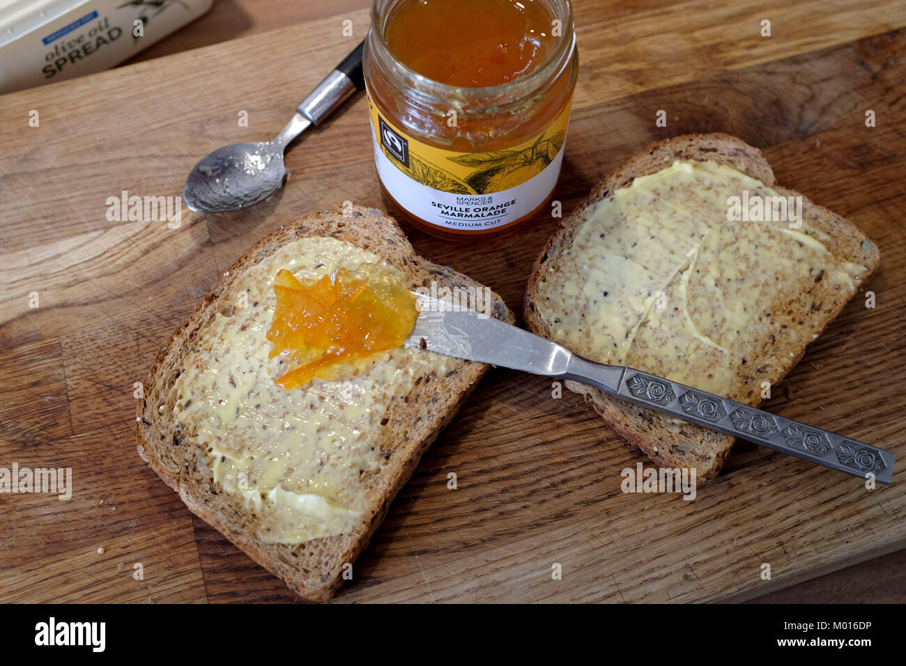 Wholemeal brown toast with M&S Seville Orange Marmalade Stock Photo