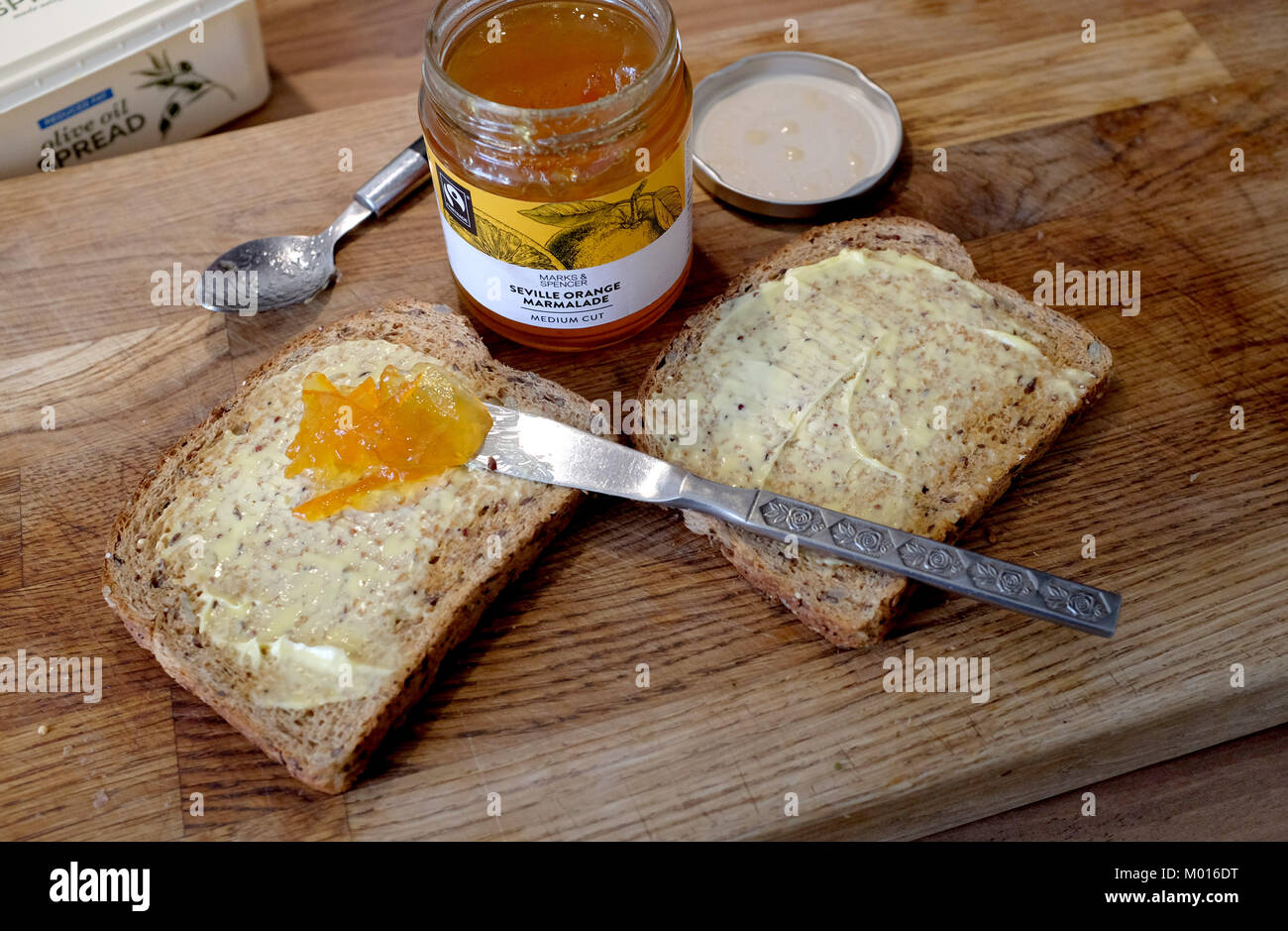 Wholemeal brown toast with M&S Seville Orange Marmalade - Stock Image