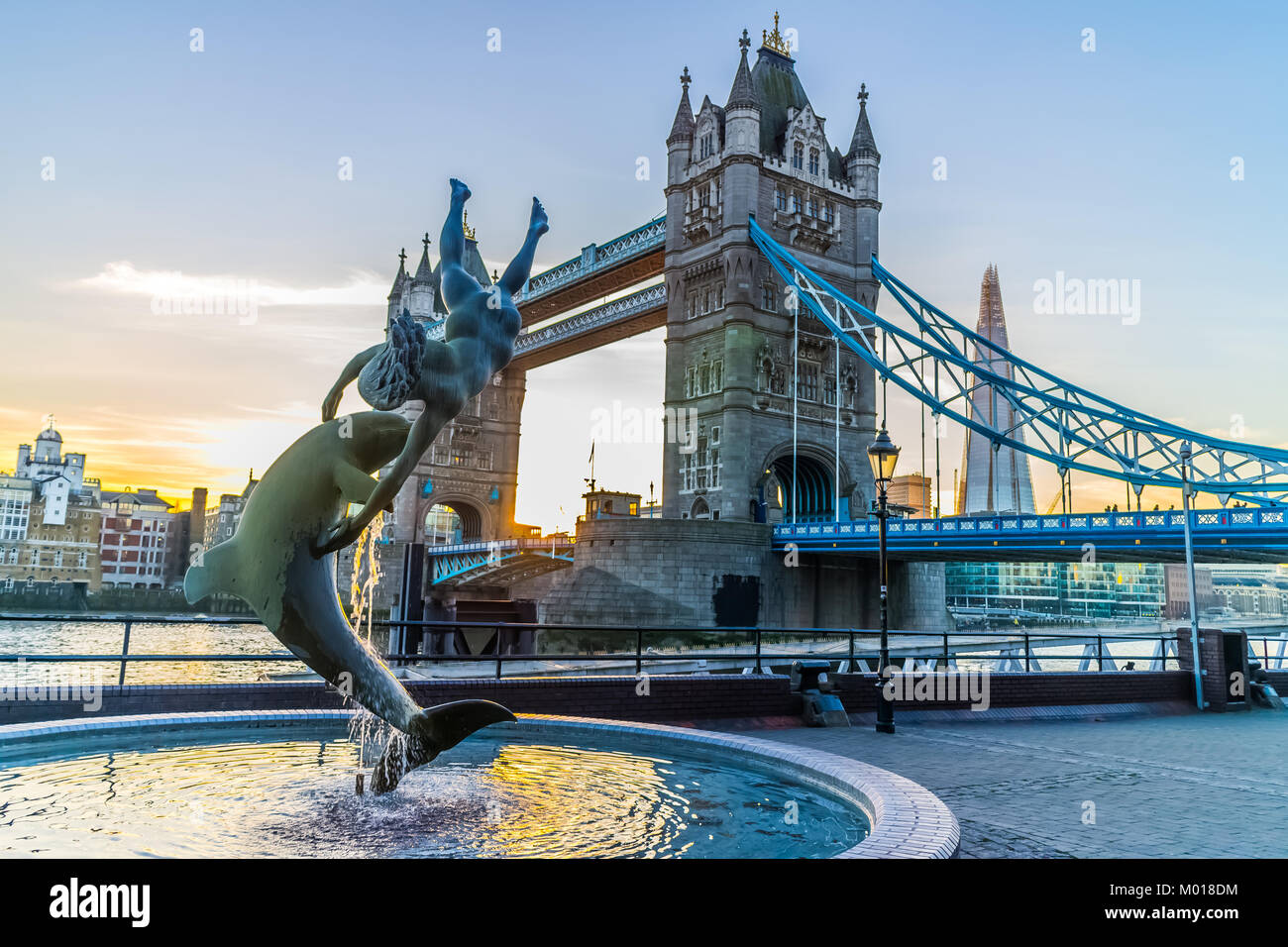 Girl with dolphin with Tower Bridge, River Thames, London. Stock Photo