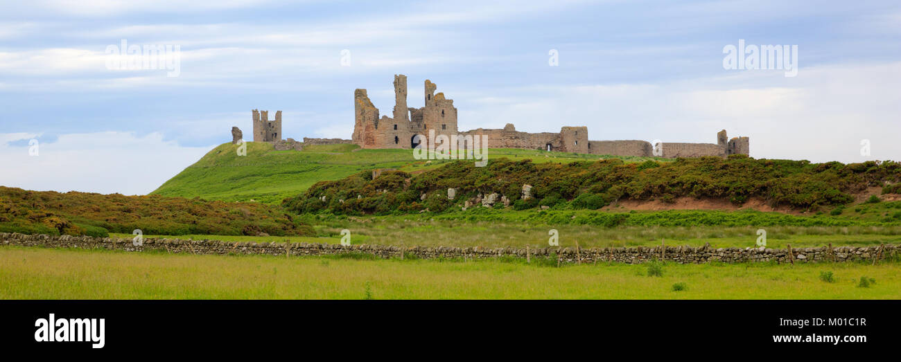English medieval castle Dunstanburgh Northumberland England uk panoramic view - Stock Image