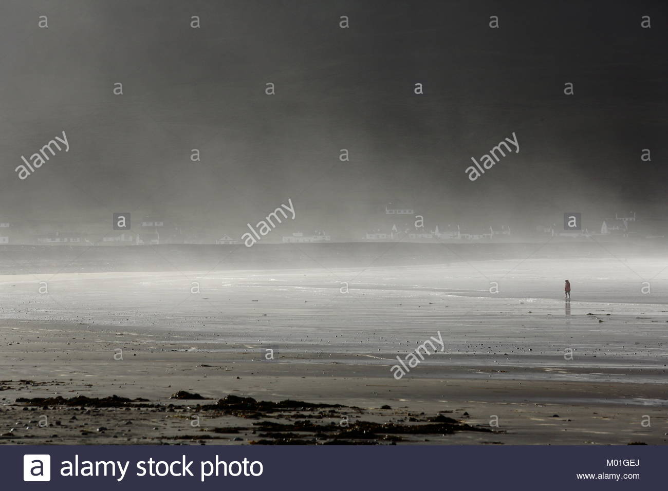 Mist in from the Atlantic Ocean sweeps across a beach on Achill Island in County Mayo, Ireland - Stock Image