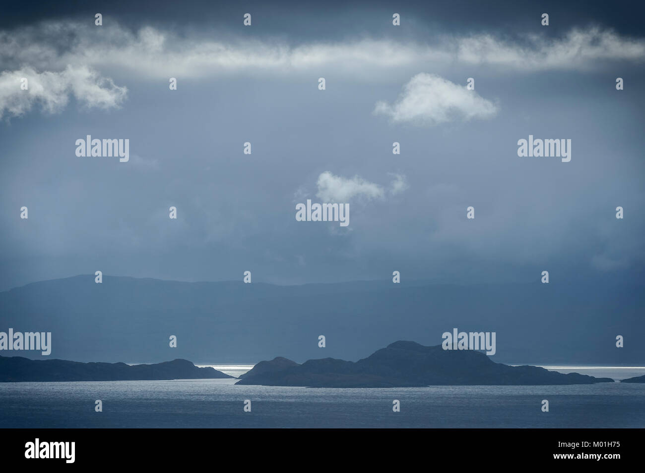 Dark clouds and stormy light over Raasay Isle from Applecross across Inner Sound Skye and Lochalsh Highland, Isle - Stock Image