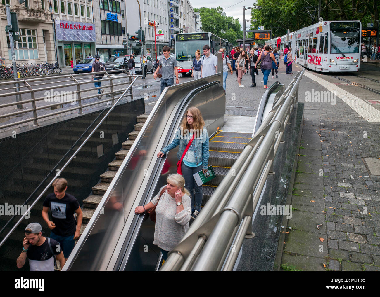 commuters entering subway entrance Neumarkt Cologne germany - Stock Image