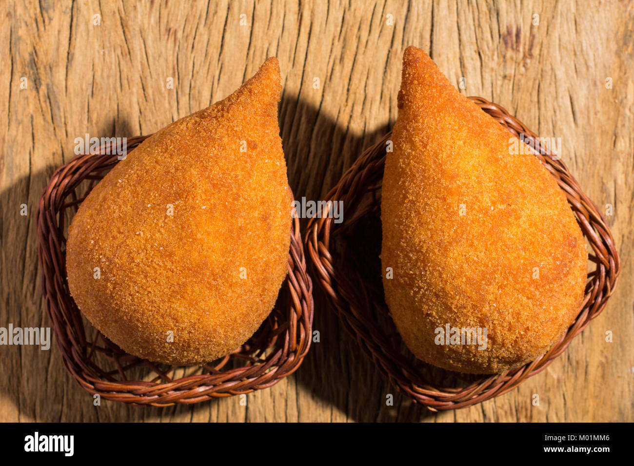 Deep fried chicken finger food known as Coxinha in Brazil. Brazilians eat as fast food alternative or at parties. - Stock Image