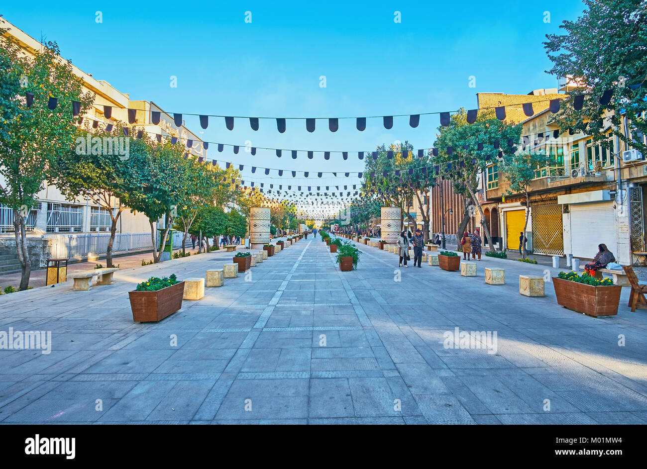 SHIRAZ, IRAN - OCTOBER 12, 2017: Zand walk street is the scenic location with shady tres and benches, located in - Stock Image