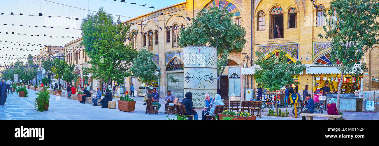 SHIRAZ, IRAN - OCTOBER 12, 2017: Panorama of Zand walking street with cozy outdoor cafes, souvenir stores and fresh - Stock Image