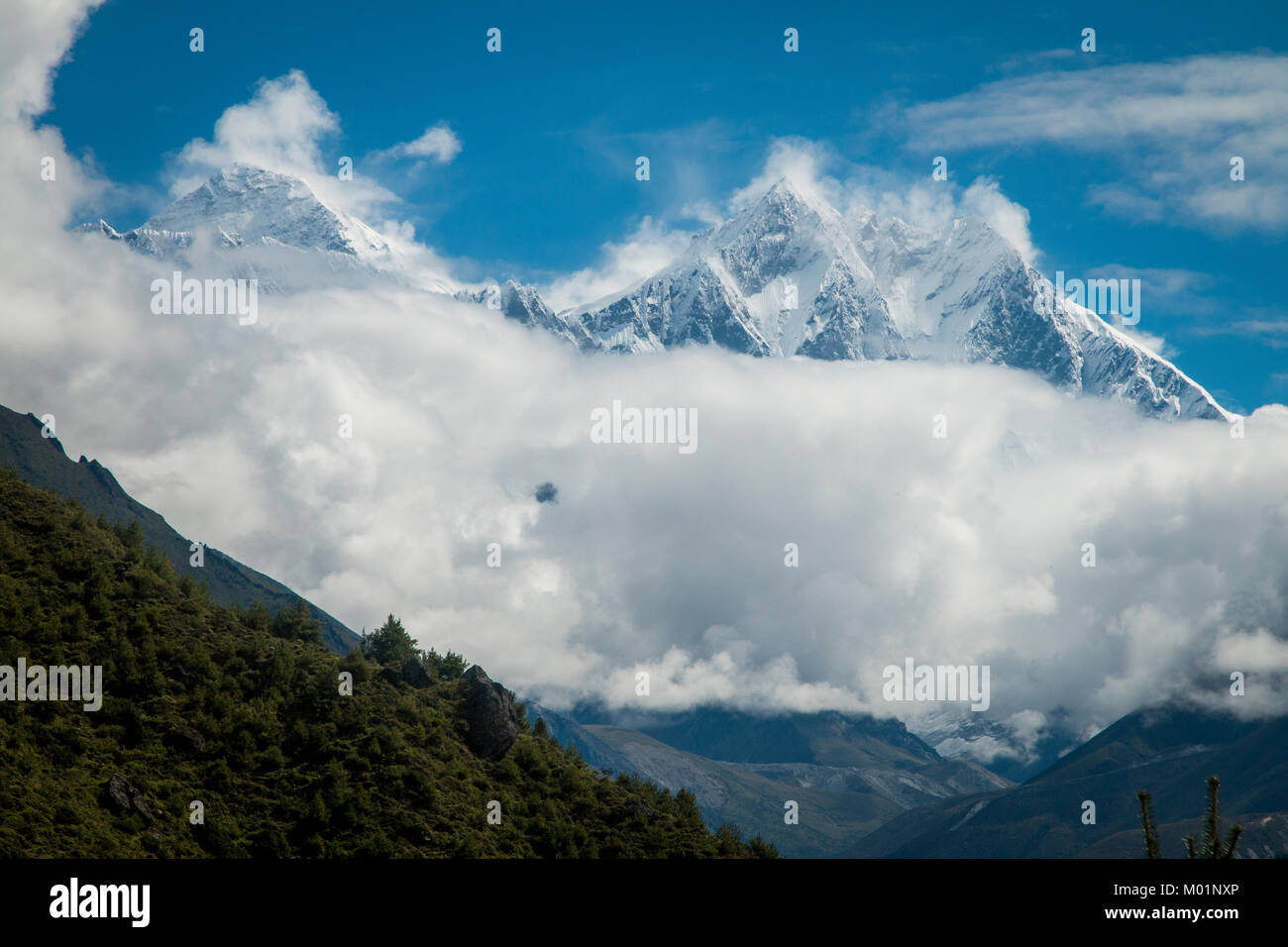 Everest and Lhotse Peaks Above Clouds, Nepal - Stock Image