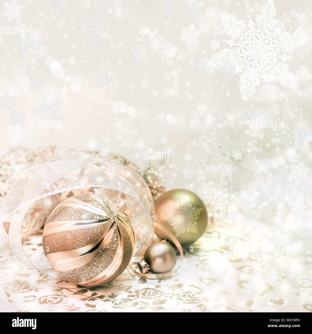 Golden Christmas decorations on abstract winter background, text space - Stock Image