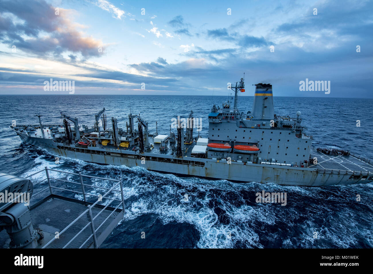 The fleet replenishment oiler USNS Yukon (T-AOE 202) participates in a fueling-at-sea with Nimitz-class aircraft - Stock Image